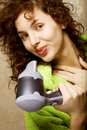 Woman drying her hair with hairdryer Stock Photos