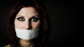 Woman with duct tape over mouth Stock Photo