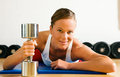 Woman with dumb bell in the gym Stock Photography