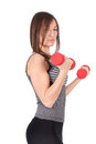 Woman with dumbbell in hand Royalty Free Stock Photography
