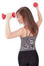 Woman with dumbbell in hand Stock Photography