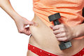 Woman with dumbbell showing fatty deposits on waist and holding Royalty Free Stock Image