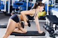 The woman with dumbbells in sports club Royalty Free Stock Photography