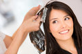 Woman dying her hair brunette at the beauty salon Royalty Free Stock Photo