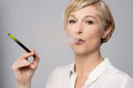 Woman with e-cigarette. Royalty Free Stock Photo