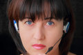 Woman in earphone with blue eyes portrait of young Stock Photography