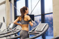 Woman with earphones exercising on treadmill Royalty Free Stock Photo
