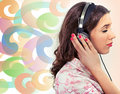 Woman earphones over colorful background Stock Photo