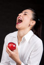 Woman eat red apple