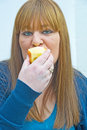 Woman eating an apple. Royalty Free Stock Photography