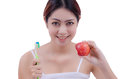 Woman eating apple with great teeth holding toothbrush and isolated on white background Stock Image