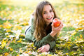 Woman eating apple outdoors in autumn Royalty Free Stock Photo