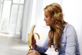 Woman eating banana Royalty Free Stock Photography