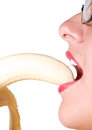 Woman Eating Banana Isolated Royalty Free Stock Photography