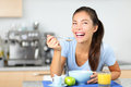 Woman eating breakfast cereals Stock Image