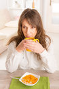 Woman eating breakfast at home Royalty Free Stock Photo