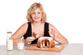 Woman eating bundt cake sweet Royalty Free Stock Image