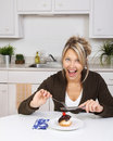 Woman eating cake Stock Image