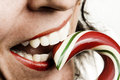 Woman Eating Candy Cane Stock Images