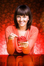Woman eating cherries Stock Photo