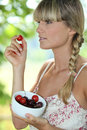 Woman eating cherries Royalty Free Stock Photography