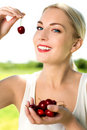 Woman eating cherries Royalty Free Stock Images