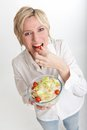 Woman eating a cherry tomato Royalty Free Stock Photo
