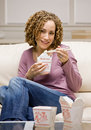 Woman eating chinese take-out food Royalty Free Stock Photo