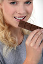 Woman eating chocolate as a special treat Royalty Free Stock Photo