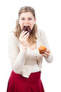 Woman eating chocolate donut and sweet muffin Stock Image