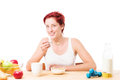 Woman eating cornflakes at breakfast happy fitness on white background Royalty Free Stock Photo