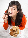 Woman eating crunchy chocolate bar Stock Image