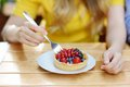 Woman eating custard fruit tart Royalty Free Stock Photo