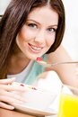 Woman eating dieting breakfast girl healthy muesli milk strawberry orange juice Stock Images