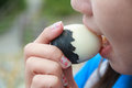 Woman eating egg boiled eggs with eggs black shell Royalty Free Stock Photo