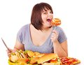 Woman eating fast food. Stock Photos