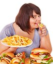 Woman eating fast food. Royalty Free Stock Photos