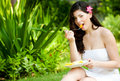 Woman Eating Fruits Stock Photo