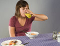 Woman eating gluten free breakfast young s drinking juice with a Stock Photography