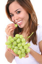 Woman Eating Grapes Stock Images