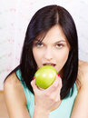 Woman eating green apple pretty Stock Image