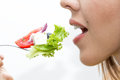 Woman eating healthy food, Greek salad Royalty Free Stock Photo