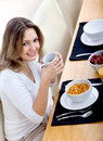 Woman eating her breakfast Stock Photography