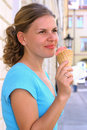 Woman eating ice-cream Royalty Free Stock Image