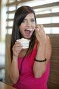 Woman eating an ice-cream. Royalty Free Stock Photos