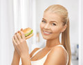 Woman eating junk food Stock Images