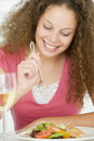 Woman Eating meal,mealtime With A Glass Of Wine Royalty Free Stock Image