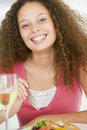Woman Eating meal,mealtime With A Glass Of Wine Royalty Free Stock Images