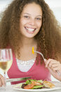 Woman Eating meal,mealtime With A Glass Of Wine Stock Photos
