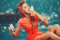 Woman eating melted ice-cream Royalty Free Stock Photo